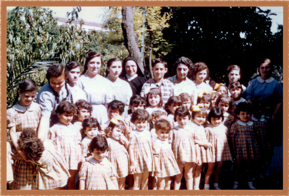 Don Dana (top row middle) with the orphans of La Piccola Casa di San Antonio in 1960